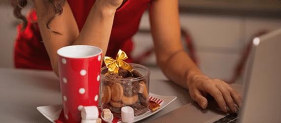 © Citalliance | Dreamstime.com - Closeup On Happy Woman Having Christmas Snacks And Usign Laptop Photo